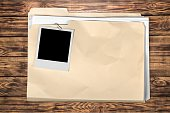 Yellow file folder on wooden background
