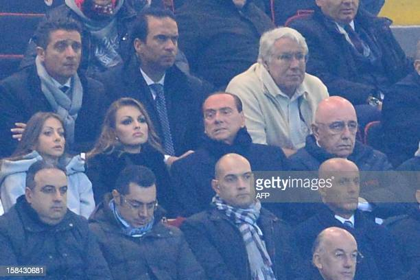 A file picture show AC Milan's sporting director Adriano Galliani and AC Milan's president Silvio Berlusconi with his new girlfriend Francesca...