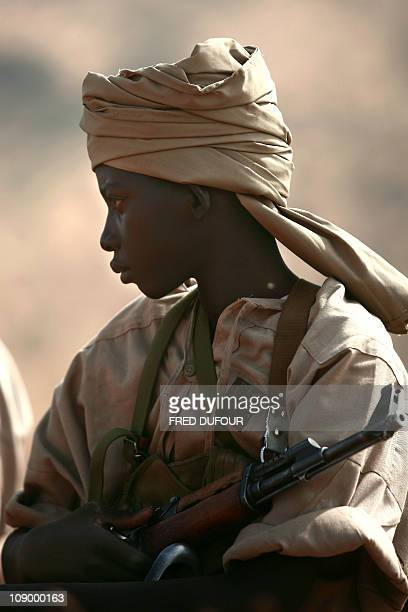 A file picture shows a child Republican Guard of Djabal as he waits for French Minister for Defense Herve Morin during a visit to the refugee camp...
