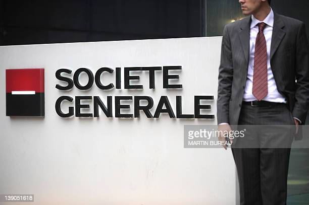 A file picture shows a man standing near the logo of Societe Generale on 24 January 2008 in La Defense outside Paris French banking giant Societe...