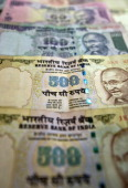 A file picture shows Indian Currency notes in New Delhi on December 7 2011 India's central bank is expected to keep interest rates on hold on January...