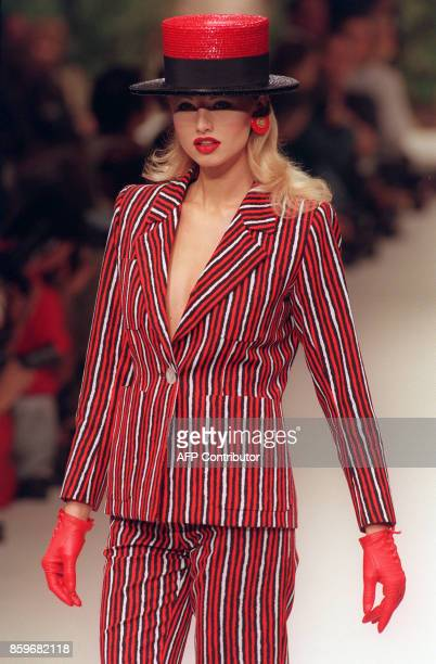 A file picture shows Slovak top model Adriana Karembeu presenting an ensemble of French designer Yves Saint Laurent 16 October 1994 in Paris during...