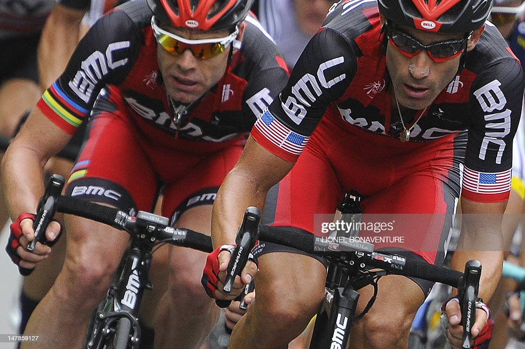A file picture shows US George Hincapie (R) riding in the pack with Tour de France 2011 winner, Australia's Cadel Evans during the 197 km and third stage of the 2012 Tour de France cycling race starting in Orchies and finishing in Boulogne-sur-Mer, northern France, on July 3, 2012. Four former teammates of Lance Armstrong, George Hincapie, Levi Leipheimer, Christian Vande Velde and David Zabriskie, will receive six month bans after they confessed to doping and testified against the seven-time Tour de France winner, as reported on July 5, 2012 by De Telegraaf. They are said to have given evidence in the USADA investigation which has charged Armstrong with doping. All four riders are currently taking part in the Tour de France, but in recent weeks, USA Cycling revealed they opted not to be considered for the Olympic Games.