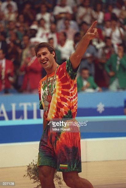 Special to St Petersburg Times Aug 1992 Sarauus Marciulionig of the Lithuanian basketball team receives the Bronze medal during the 1992 Olympic...