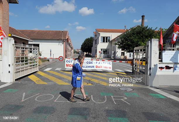 File picture taken on August 11 2009 in VillemursurTarn southwestern France shows an employee of USowned car parts supplier Molex walking in front of...