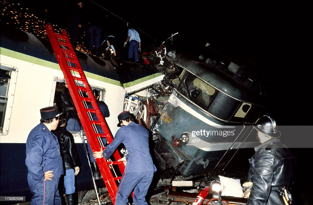 A file picture taken on August 31, 1985 shows the wreckage of a train after it derailed and collided with another train in Argenton-sur-Creuse, central France. At least six people were killed and dozens were injured on July 12, 2013 when a train derailed as it passed through a station at Bretigny-sur-Orge, about 25 kilometres (15 miles) south of Paris. This latest accident is the worst train catastrophe since June 2, 2008 when a passenger train linking Evian-les-Bains and Geneva hit a school bus at a level crossing near the town of Allinges, in the French Alps.