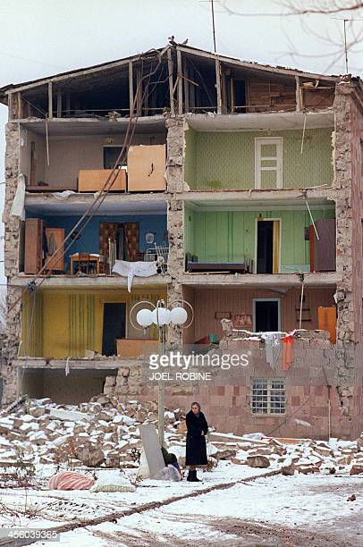 A file picture taken on December 15 after devastating earthquake shows woman standing near a destroyed building in Leninakan the second largest city...