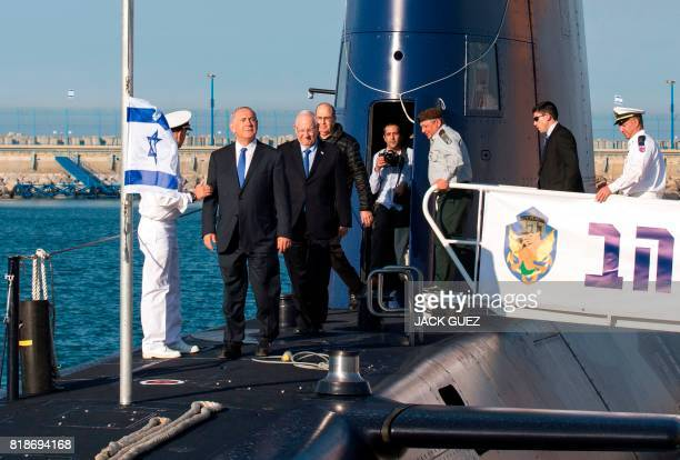 A file picture taken on January 12 2016 shows Israeli Prime Minister Benjamin Netanyahu and Israeli President Reuven Rivlin attending a ceremony for...