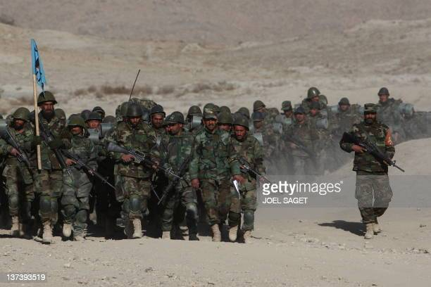 A file picture taken on January 13 at the Kabul Military Training Camp near Kabul shows Afghan trainee officers of the Afghan National Army marching...