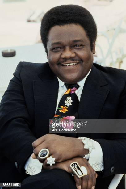 A file picture taken on July 18 1980 shows US pianist and singersongwriter Fats Domino posing for a picture with valuable rings during the 'Grande...