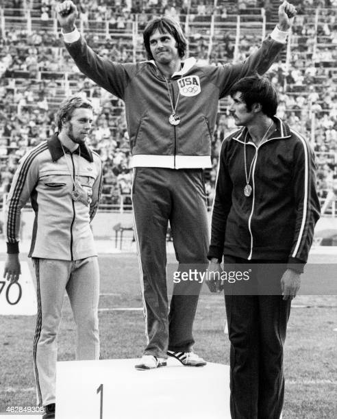 A file picture taken on July 30 1976 in Montreal shows USA's Bruce Jenner celebrating his gold medal on the podium after winning the men's decathlon...