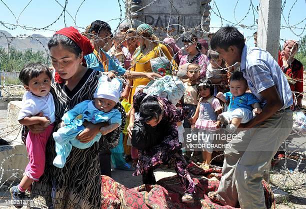 A file picture taken on June 18 shows ethnic Uzbek refugees crossing the KyrgyzUzbek border on their way back to Kyrgyzstan near the village of Vlksm...