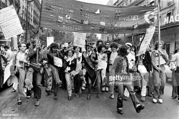 A file picture taken on June 25 1977 shows people holding signs and a banner reading 'Homosexual Liberation Group Politics and daily life' during the...