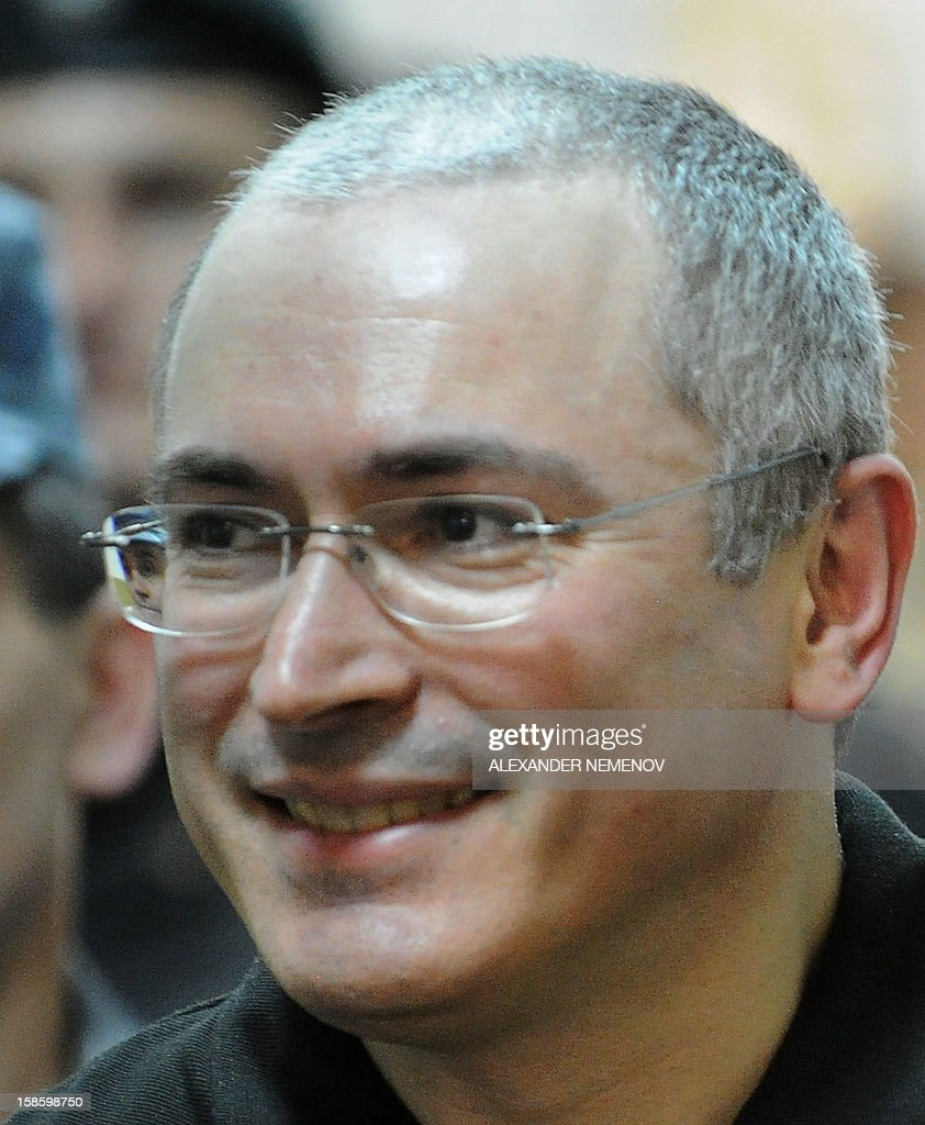 A file picture taken on June 3, 2011, shows former Yukos oil company CEO Mikhail Khodorkovsky smiling in a courtroom in Moscow.