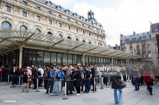 A file picture taken on March 26 2010 in Paris shows People waiting to enter at the Musee d'Orsay museum The Musee d'Orsay is closed again on October...