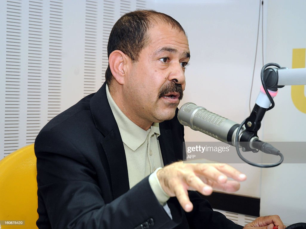A file picture taken on November 20, 2012 shows Tunisian lawyer and opposition leader Chokri Belaid speaking during a radio interview in Tunis. Chokri Belaid, who was gunned down outside his home on February 6, was a fierce opponent of Tunisia's ruling Islamists and a pan-Arab, left-wing activist propelled to the front of the political scene after the revolution. AFP PHOTO / KHALIL