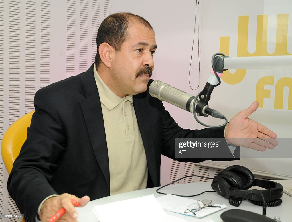 A file picture taken on November 20, 2012 shows Tunisian lawyer and opposition leader Chokri Belaid speaking during a radio interview in Tunis. Chokri Belaid, who was gunned down outside his home on February 6, was a fierce opponent of Tunisia's ruling Islamists and a pan-Arab, left-wing activist propelled to the front of the political scene after the revolution.