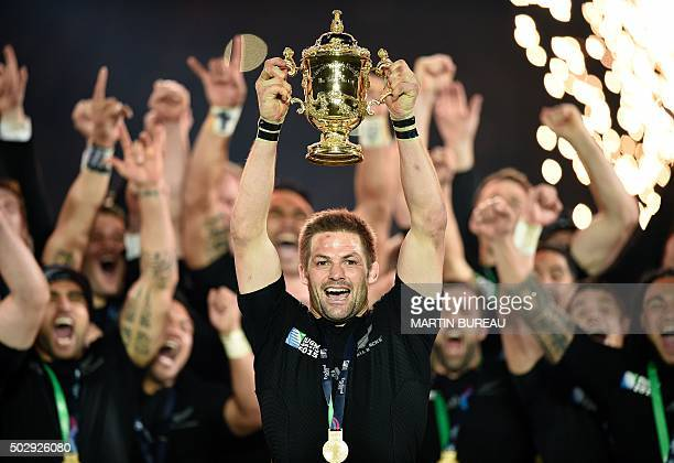 A file picture taken on October 31 2015 shows New Zealand's flanker and captain Richie McCaw lifting the Webb Ellis Cup after winning 3417 during the...