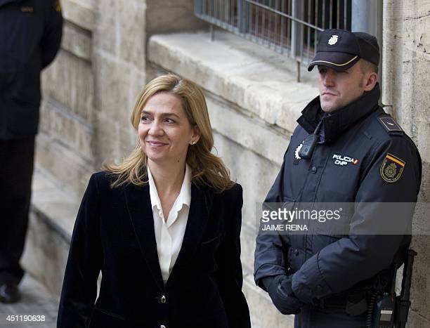 A file picture takenon February 8 2014 shows Spanish Infanta Cristina smiling as she arrives at the courthouse of Palma de Mallorca on the Spanish...