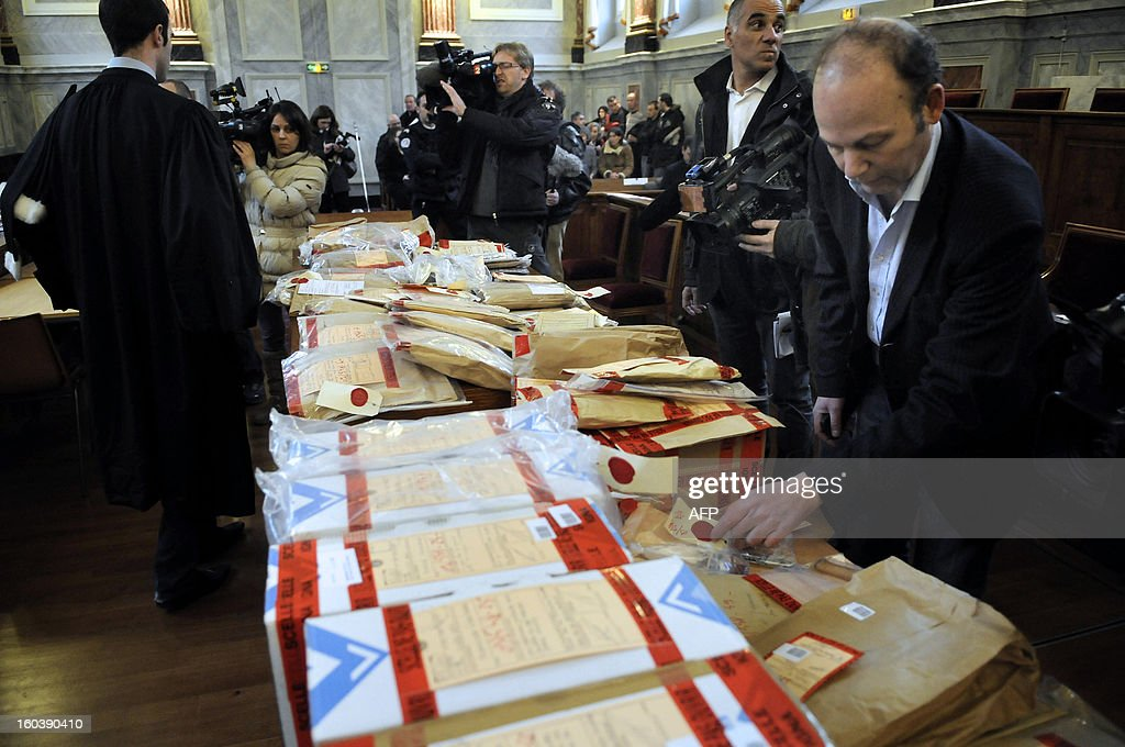 Files and official sealed documents are displayed on January 30, 2013 at the courthouse in Pau, southwestern France, during the trial of six suspects at the criminal court for minors for the killing of Jeremy Censier in 2009. The six suspects were under-age when Jeremy Censier, aged 19, was severedly beaten and fatally stabbed during a party in the French southwestern village of Nay, near Pau, during the night of August 21 to 22 2009.