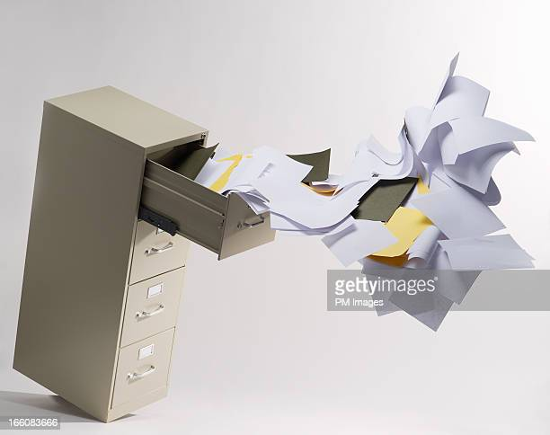 Files flying out of file cabinet