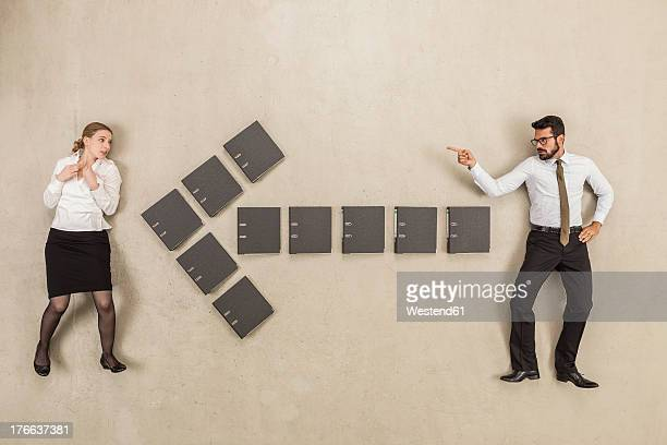 Files forming arrow sign between two business people