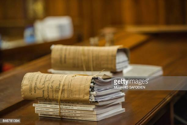Files in South African president's spy tape case are pictured at the Supreme Court of Appeal in Bloemfontein on September 14 2017 South Africa's...