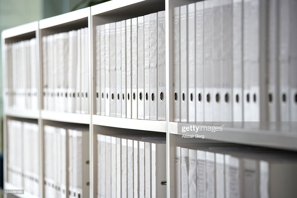 Files on shelves in an office