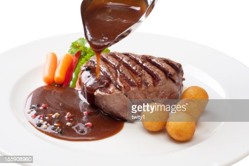 Filet mignon with sauce on a white plate