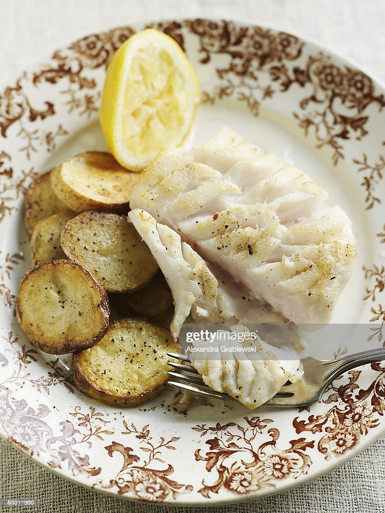 Filet of Cod with pan roasted potatoes : Stock Photo