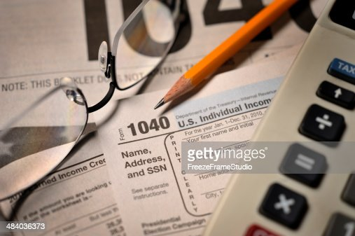 Filing taxes on IRS Form 1040 close-up view