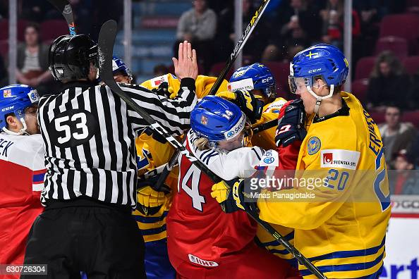 Filip Chlapik of Team Czech Republic and Joel Eriksson Ek of Team Sweden get involved in a scuffle during the 2017 IIHF World Junior Championship...