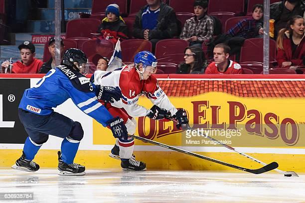 Filip Chlapik of Team Czech Republic skates the puck during the IIHF World Junior Championship preliminary round game Urho Vaakanainen of Team...