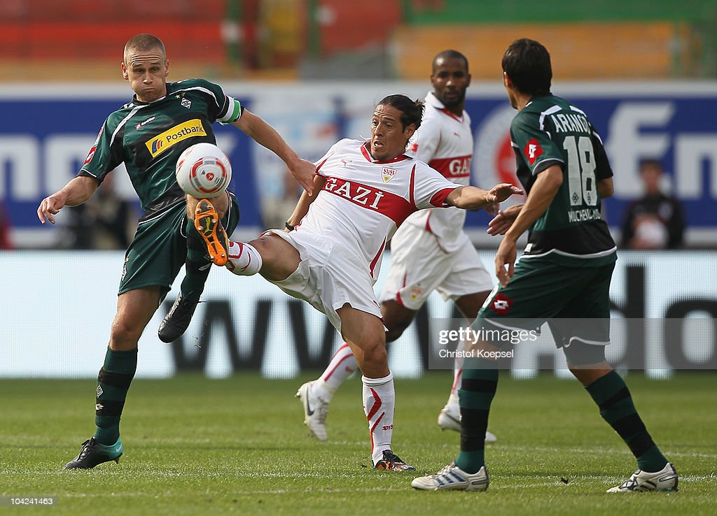 Filip Daems (L) challenges Mauro Camoranesi of Stuttgart (C) during the Bundesliga match between VfB Stuttgart and Borussia Moenchengladbach at Mercedes-Benz Arena on September 18, 2010 in Stuttgart, Germany.