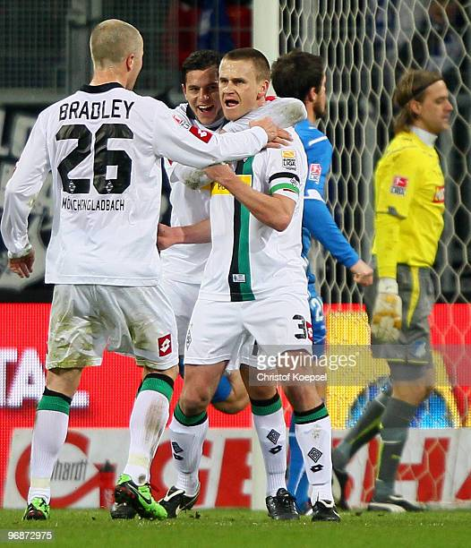 Filip Daems of Gladbach celebrates after scoring his team's first goal with team mates Michael Bradley of Gladbach and Rául Marcelo Bobadilla during...