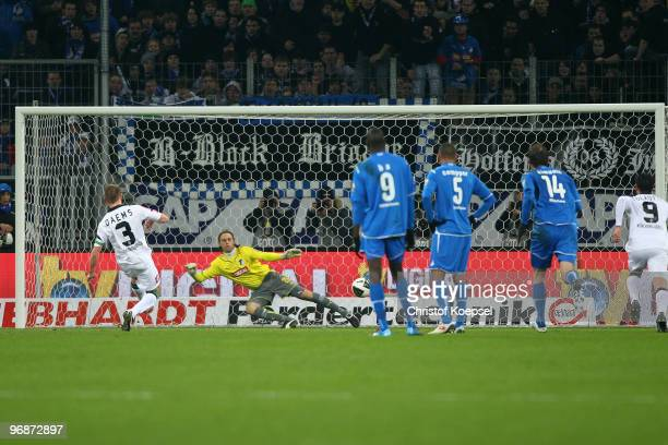 Filip Daems of Gladbach scores his team's first goal by penalty against goalkeeper Timo Hildebrand of Hoffenheim during the Bundesliga match between...
