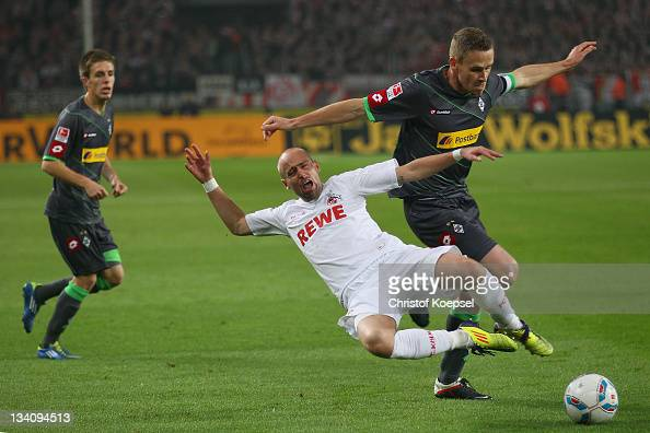Filip Daems of Moenchengladbach challenges Miso Brecko of Koeln during the Bundesliga match between 1 FC Koeln and Borussia Moenchengladbach at...