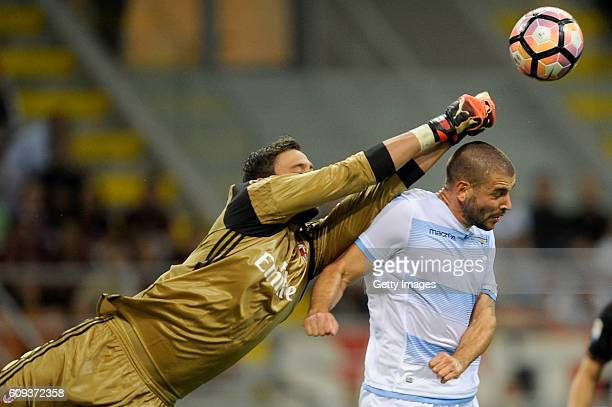 Filip Djordjevic of SS Lazio and Gianluigi Donnarumma of AC Milan in action during the Serie A match between AC Milan and SS Lazio at Stadio Giuseppe...