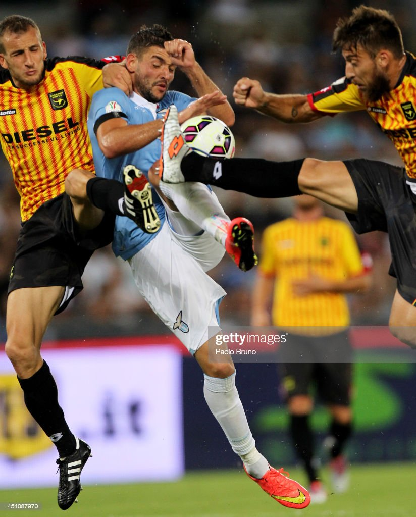 Filip Djordjevic (C) of SS Lazio competes for the ball with Giusto Priola (L) and Dario Toninelli of Bassano FC during the TIM Cup match between SS Lazio and Bassano FC at Olimpico Stadium on August 24, 2014 in Rome, Italy.
