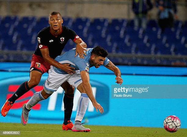 Filip Djordjevic of SS Lazio competes for the ball with Sebastien De Maio of Genoa CFC during the Serie A match between SS Lazio and Genoa CFC at...