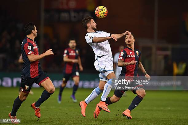 Filip Djordjevic of SS Lazio controls the ball against Armando Izzo and Nicolas Burdisso of Genoa CFC during the Serie A match between Genoa CFC and...