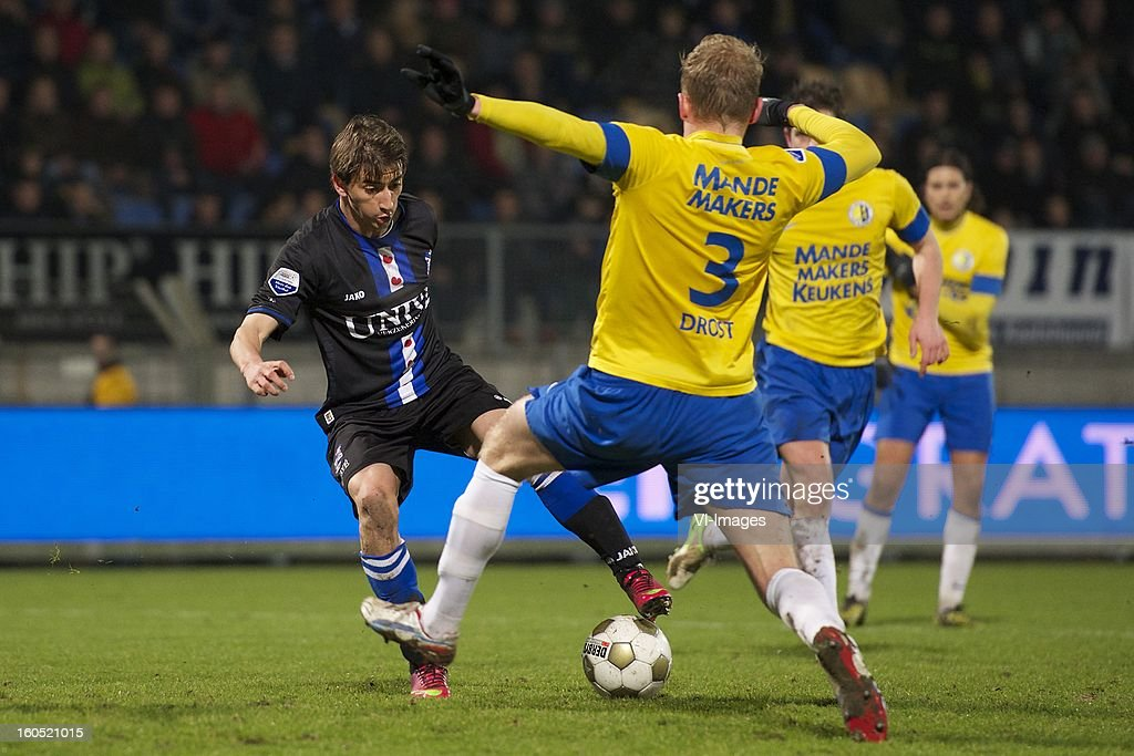 Filip Djuricic of Heerenveen, Henrico Drost of RKC Waalwijk, Sander Duits of RKC Waalwijk during the Dutch Eredivisie match between RKC Waalwijk and SC Heerenveen at the Mandemakers Stadium on february 1, 2013 in Waalwijk, The Netherlands