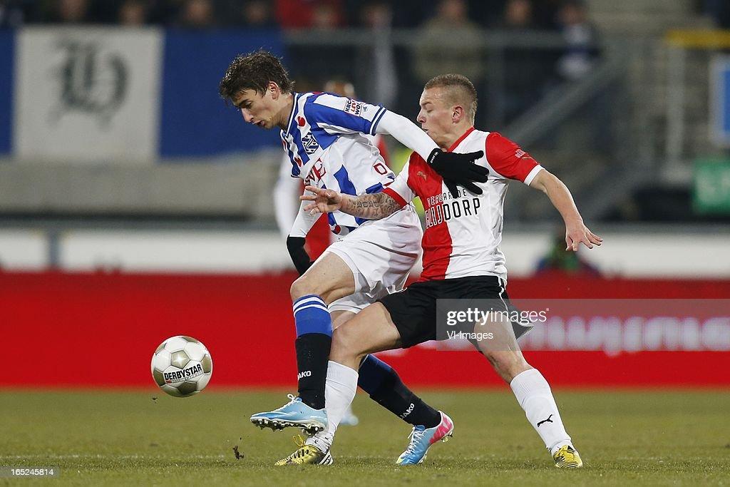 Filip Djuricic of Heerenveen,Jordy Clasie of Feyenoord during the Dutch Eredivisie match between SC Heerenveen and Feyenoord at the Abe Lenstra Stadium on march 30, 2013 in Heerenveen, The Netherlands