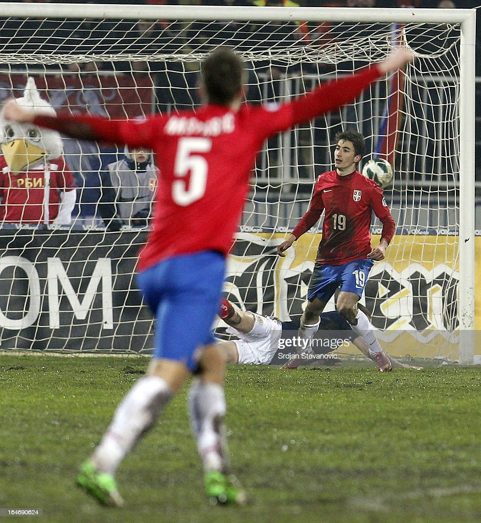 Filip Djuricic (R) of Serbia celebrates scoring the opening goal during the FIFA 2014 World Cup Qualifier match between Serbia and Scotland at Karadjordje Stadium on March 26, 2013 in Novi Sad, Serbia