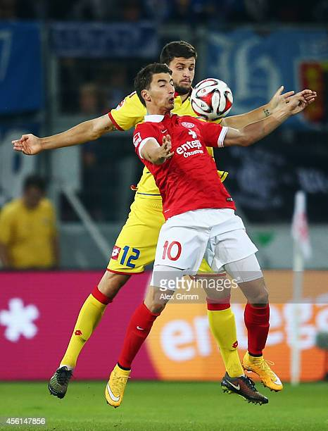 Filip Duricic of Mainz is challenged by Tobias Strobl of Hoffenheim during the Bundesliga match between 1 FSV Mainz 05 and 1899 Hoffenheim at Coface...