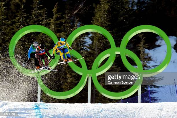 Filip Flisar of Slovenia Christopher Delbosco of Canada and Tommy Eliasson of Sweden compete in a men's ski cross race on day ten of the Vancouver...