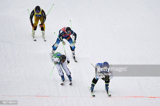 Filip Flisar of Slovenia crosses the finish line to win the gold in the Big Final of the Men's Ski Cross Finals during the FIS Freestyle Ski and...