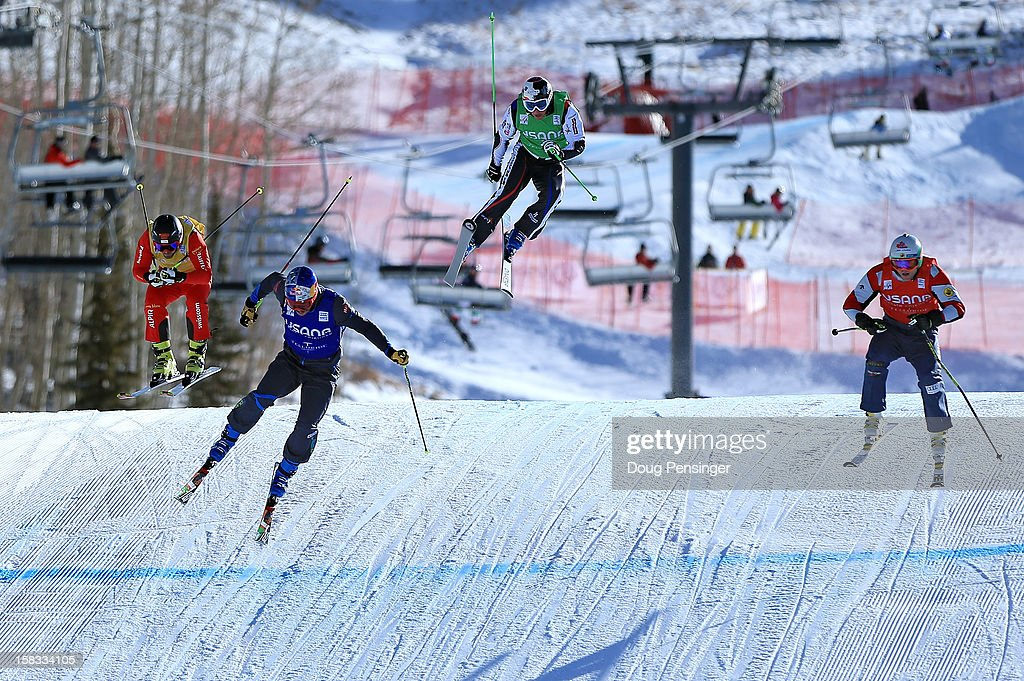 Filip Flisar (2L) of Slovenia flies to the finish in first place ahead of Brady Leman (R) of Canada in second place, Armin Niederer (L) of Switzerland in third place and Jean Frederic Chapuis of France in fourth place in the finals of men's Audi FIS Ski Cross World Cup on December 12, 2012 in Telluride, Colorado.