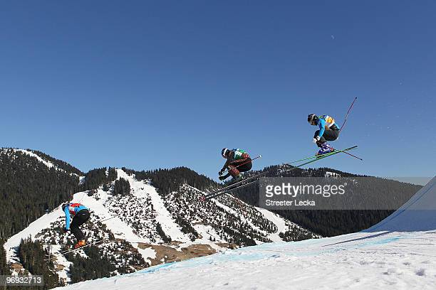 Filip Flisar of Slovenia Stanley Hayer of Canada and Hiroomi Takizawa of Japan compete in a men's ski cross race on day ten of the Vancouver 2010...