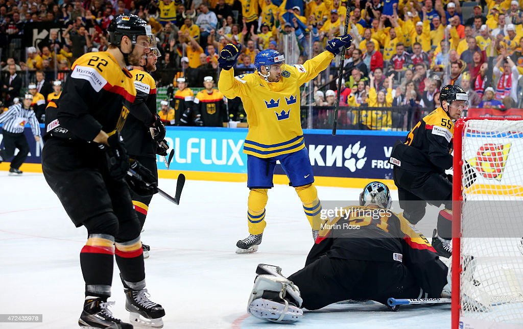 Filip Forsber (C) of Sweden celebrate his team's opening goal during the IIHF World Championship group A match between Sweden and Germany at o2 Arena on May 7, 2015 in Prague, Czech Republic.